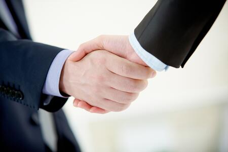 7125889_xl shaking hands