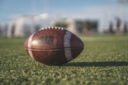 selective-focus-close-up-photo-of-brown-wilson-pigskin-2570139